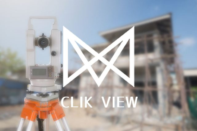 Survey equipment theodolite on a tripod. with building construction site background